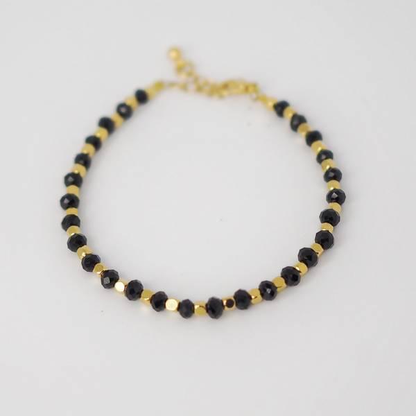 Armbånd med glassperler gull/svart