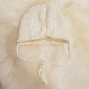 Bilde av Maximo hvit vinterlue til baby - den perfekte