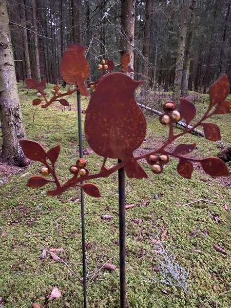 Bilde av Fugl på pinne med gulldekor