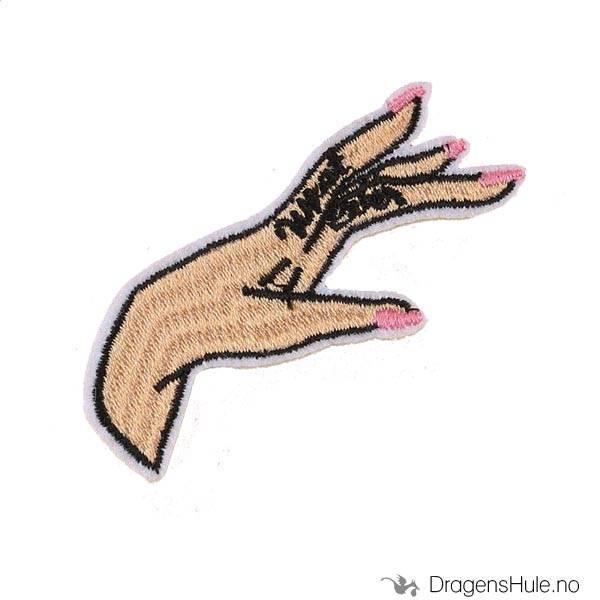 Stoffmerke: En kvinnes hånd