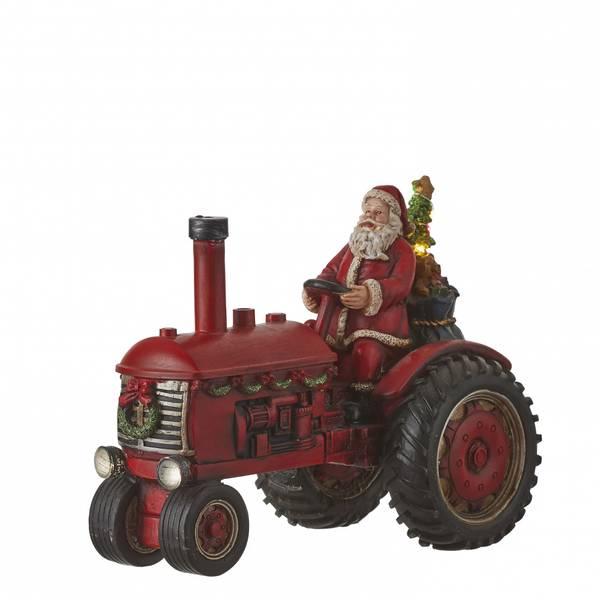 Bilde av Julenisse på rød traktor - juleby Luville