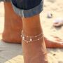 Fotlenke med perler og evighetstegn