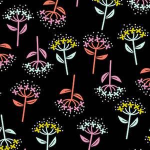 Flerfarget blomst på svart