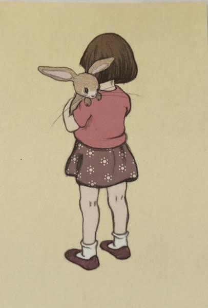 Bilde av Jente koser med kanin