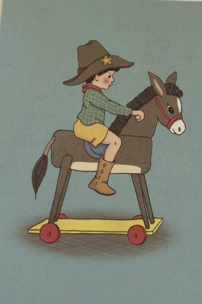 Bilde av Cowboygutt på hesteryggen