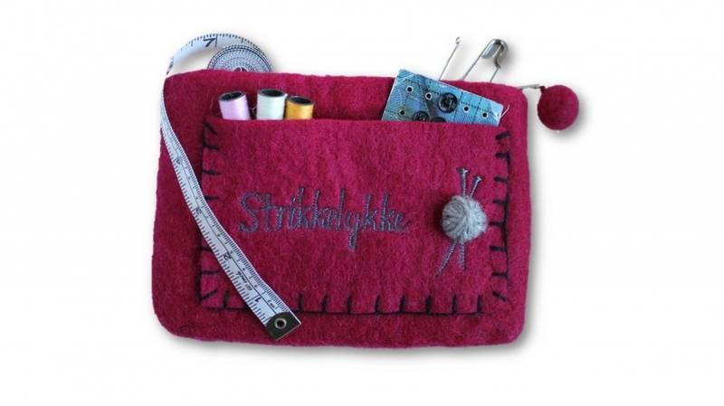 Stor pung med strikkelykke