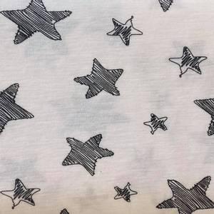 Bilde av Strikket Ull, tynn - hvit med sorte stjerner