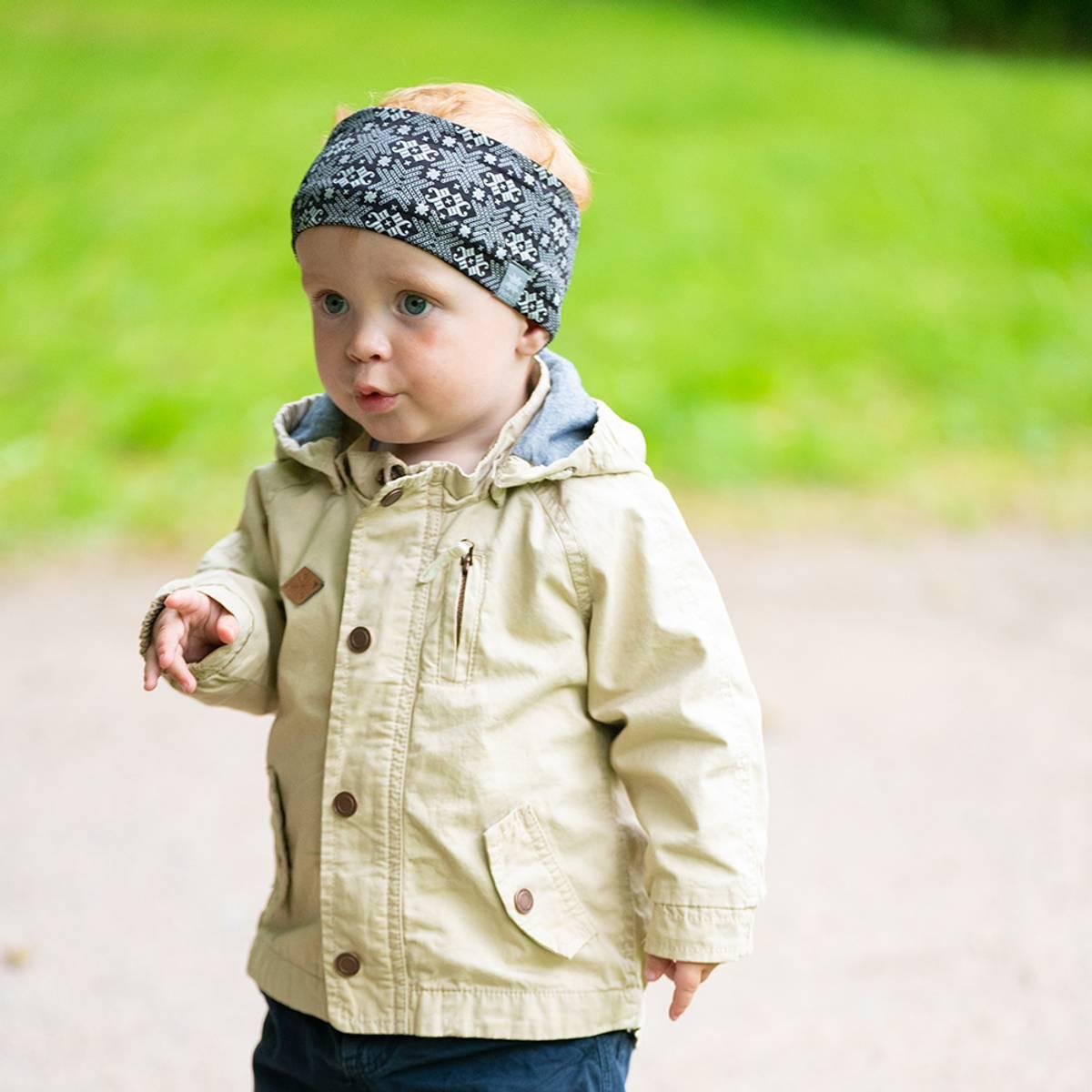 Morild Glitre Junior pannebånd med refleks, sort