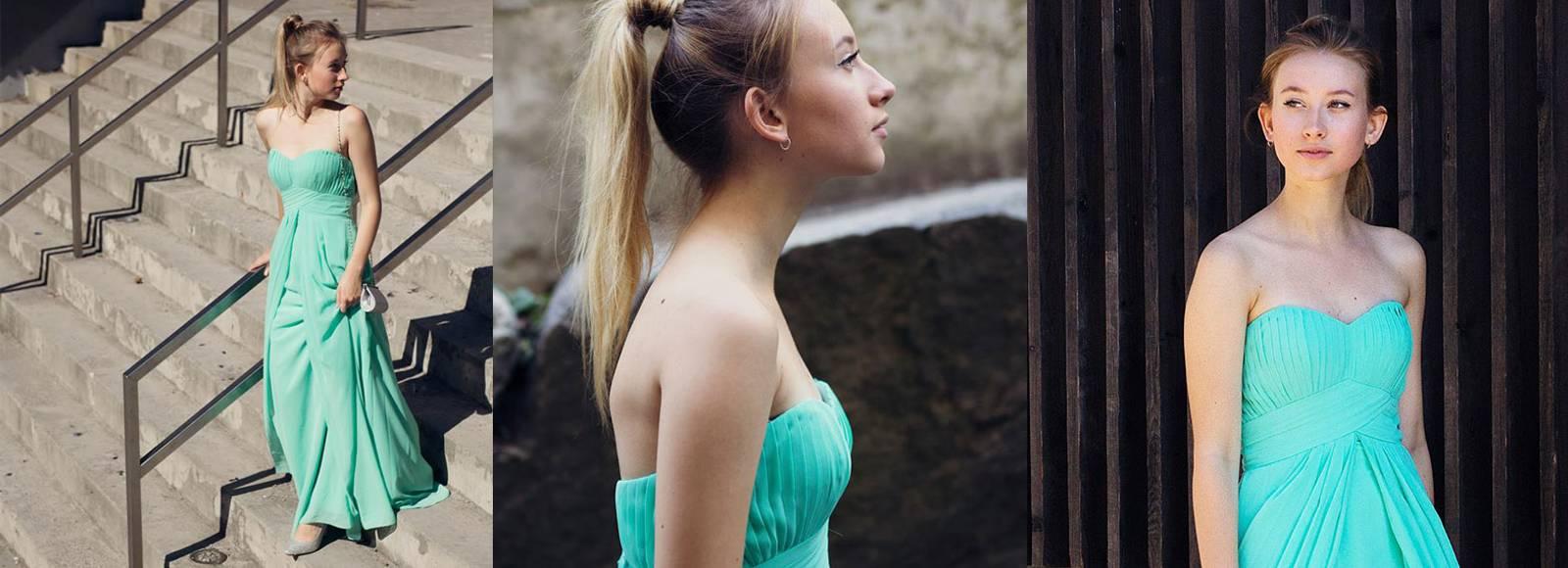 jente som har på seg lang grønn selskapskjole fra mybella