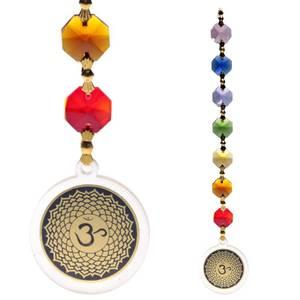 Bilde av Lysfanger - Feng Shui Ohm crown chakra pendant