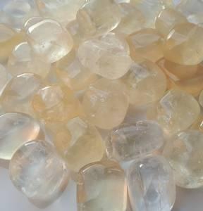 Bilde av Kalsitt gul transperante - Tromlede steiner XL
