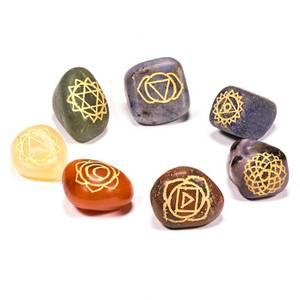 Bilde av Chakra symbols engraved tumbled stones SET of 7