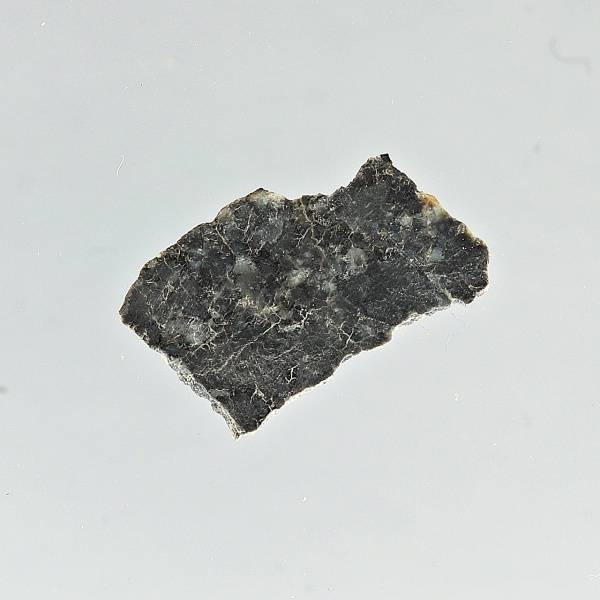 Bilde av Månemeteoritt DaG 400, 0,23 gram