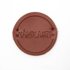 Bilde av Rund Skinnlapp Håndlaget