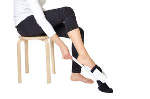 Bilde av strømpepåtrekker / hjelper til sokker