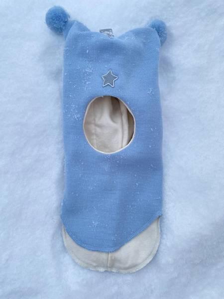 Kivat, lyseblå hettelue i ull med refleksstjerne