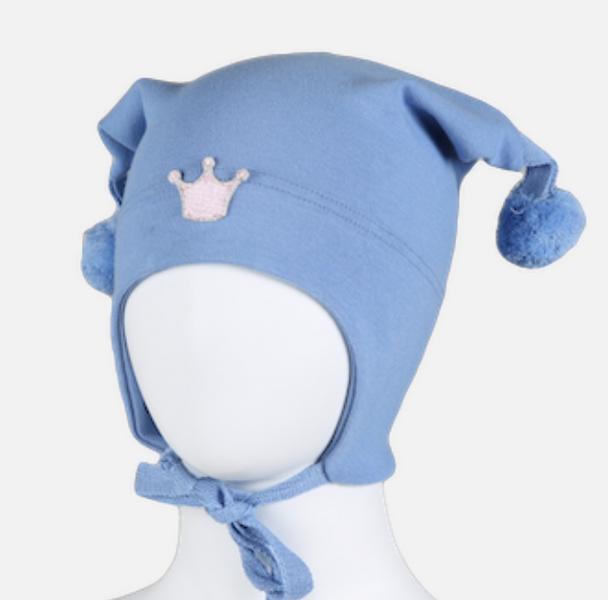 Kivat, lyseblå bomullslue med prinsessekrone og dusker