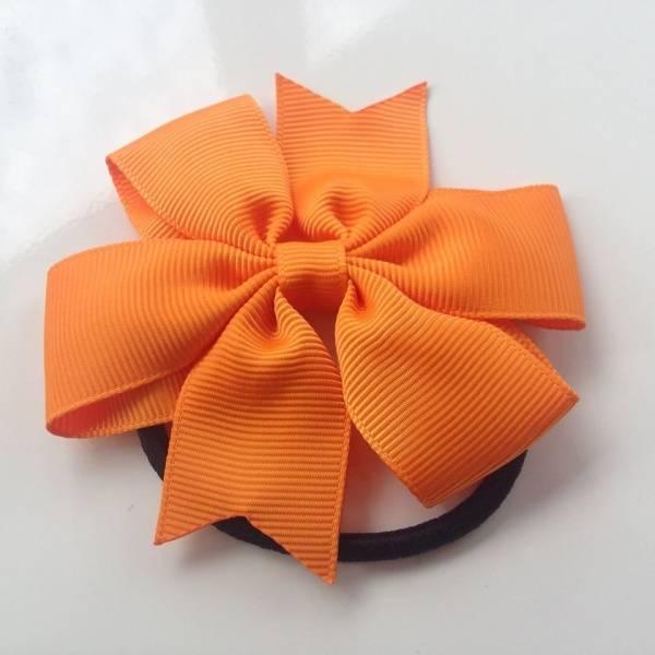 Sam & Sofie, hårstrikk med oransje sløyfe
