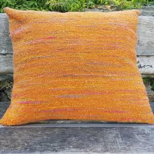 Bilde av Pute brent orange boucle ull-alpaca 55 x 48 cm