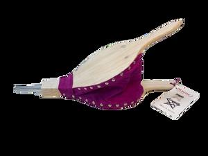 Bilde av peispuster med lilla skinn