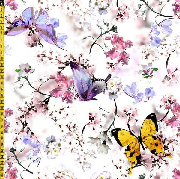 Bilde av Flerfargete sommerfugl og blomsterkvister på hvit bomullsjersey