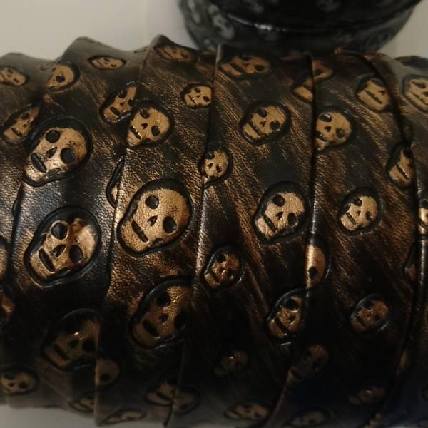 Bilde av 2 m Imitert skinn, skråbånd, sort-gull m. hodeskaller