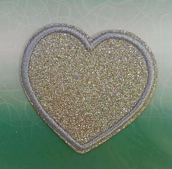 Bilde av Symerke med lim - sølvfarget hjerte med glitter, 4,5 cm stor