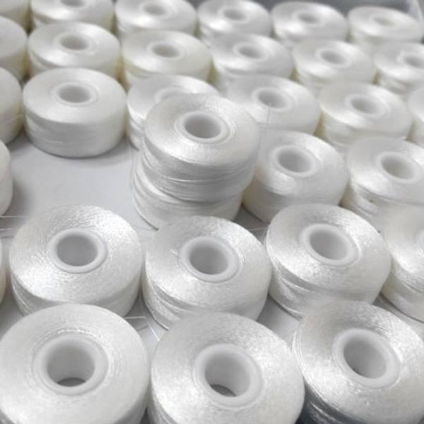 Bilde av 10 st L-style spole, polyester, hvit, uten papp