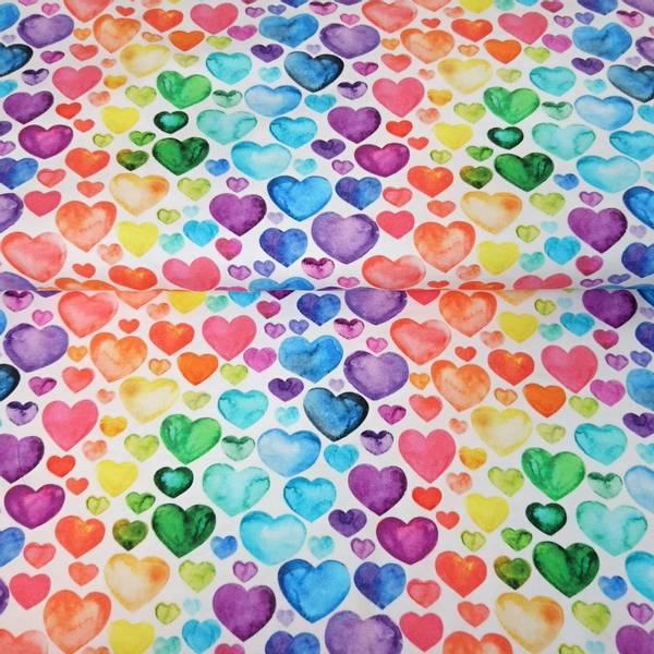 Bilde av Bomullsjersey - 1-3 cm regnbuefargete hjerter på hvit