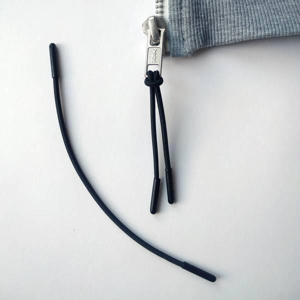 Bilde av Glidelås-påheng, rundstrikk - sort