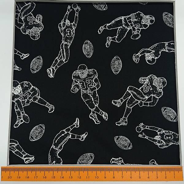 Bilde av Amerikansk fotball, 8-10 cm spillere med ball på svart bakgrunn