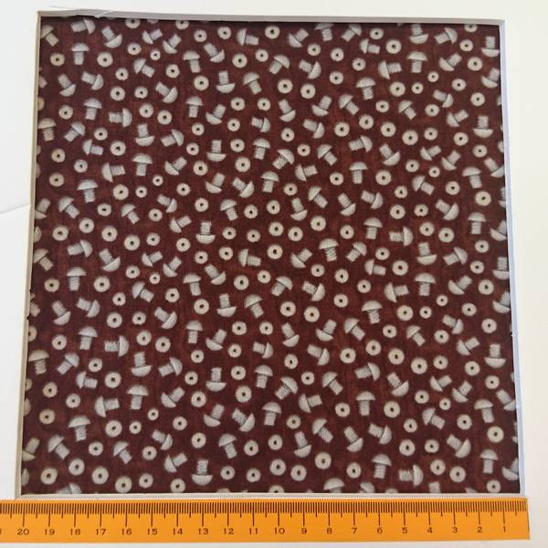 Bilde av Grå 1 cm skruer på brun
