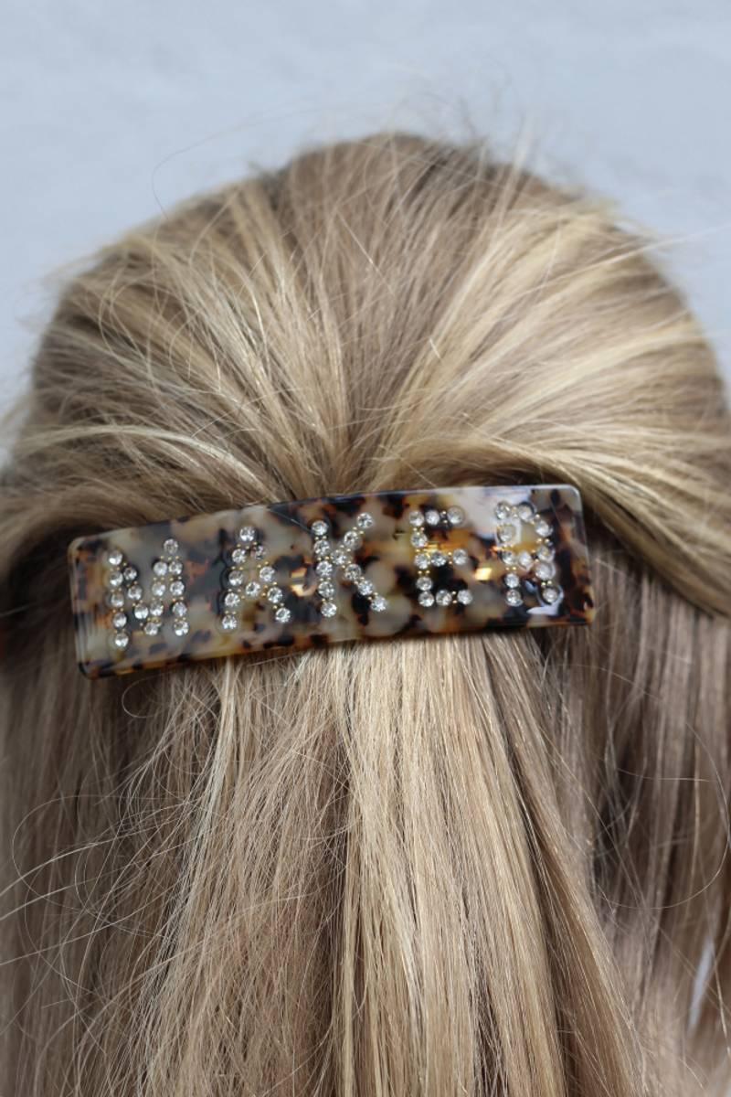 Maker hårspenne
