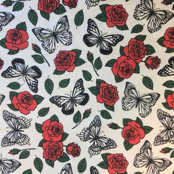 Bilde av Røde roser med sommerfugler som skifter farge i sollys