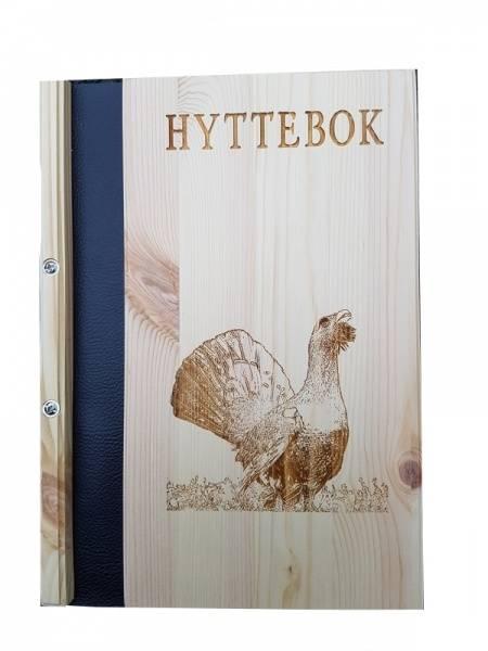 Hyttebok med motiv av tiur