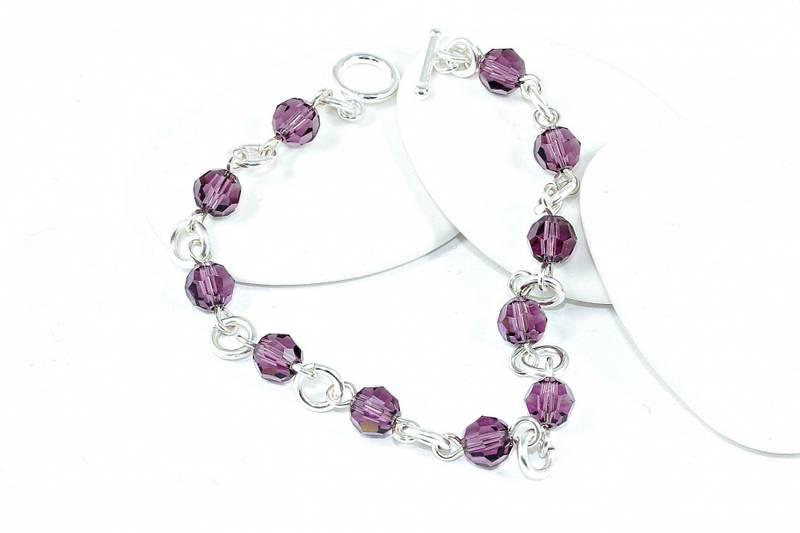 Bilde av Sølv armbånd med lilla krystaller