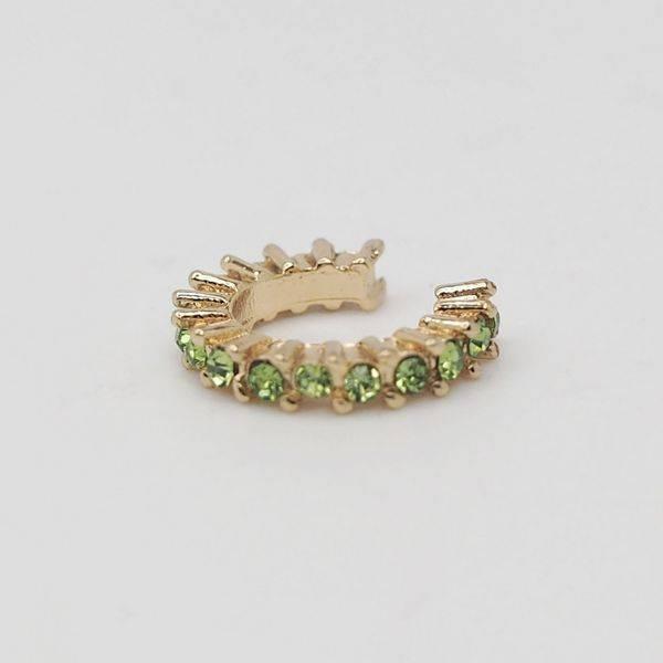 Bilde av Ørecuff i gull med lysegrønne stener