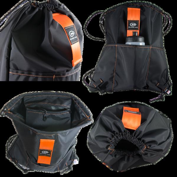 Bilde av Orange Mud Sling Bag - Black with Orange Strap
