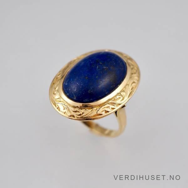 Bilde av Ring i 22 K gull med stor blå sten