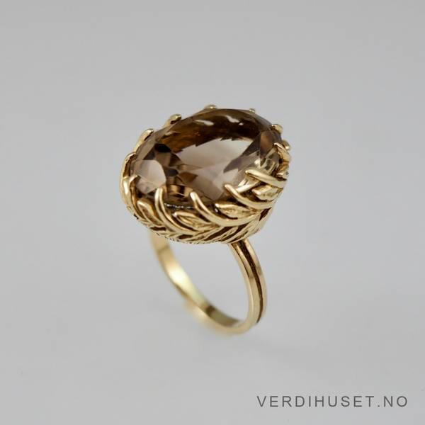 Bilde av Ring i 14 K gull med stor brun sten