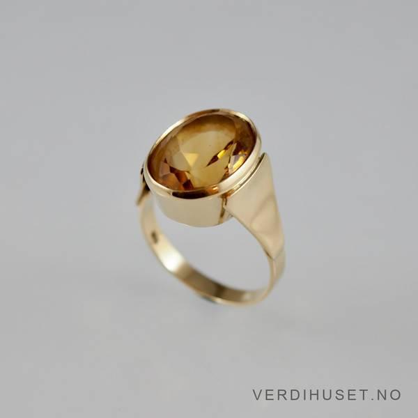 Bilde av Ring i 14 K gull med gul oval sten